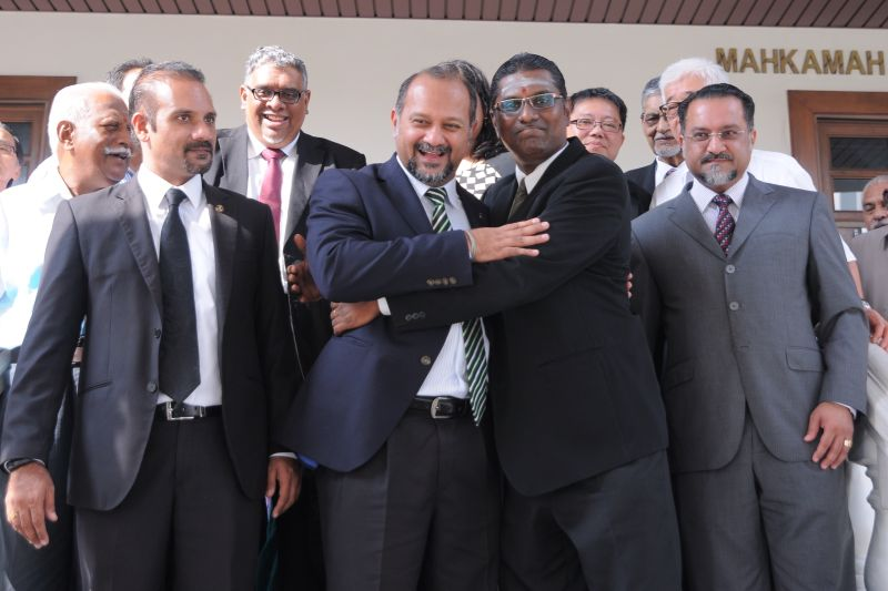 RSN Rayer (second right) is seen hugging Gobind Singh Deo at the Penang Sessions Court after he was acquitted of a sedition charge over his 'celaka Umno' remark, April 29, 2016. ― Picture by KE Ooi