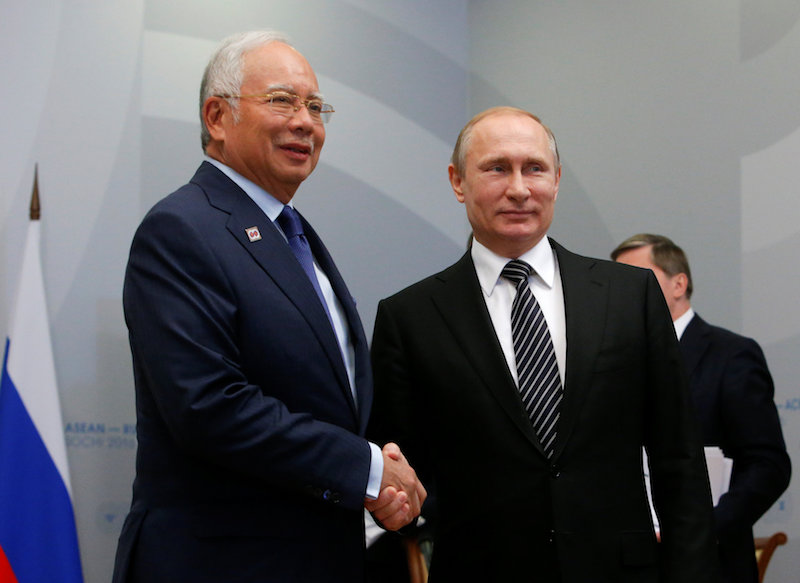 Russia's President Vladimir Putin shakes hands with Prime Minister Datuk Seri Najib Razak during a meeting on the sidelines of the Russia-Asean summit in Sochi May 19, 2016. — Reuters pic