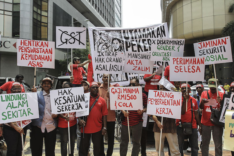 Participants hold banners during a rally held in conjunction with Labour Day in Kuala Lumpur May 1, 2016. — Picture by Yusof Mat Isa
