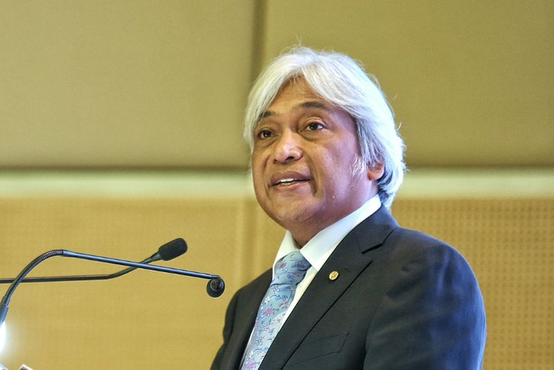 Tan Sri Muhammad Ibrahim said, effective July 1, 2018 the Instant Transfer fee of 50 sen will be waived for up to RM5,000 per transaction made by individuals and small medium enterprises (SMEs). — Picture by Saw Siow Feng