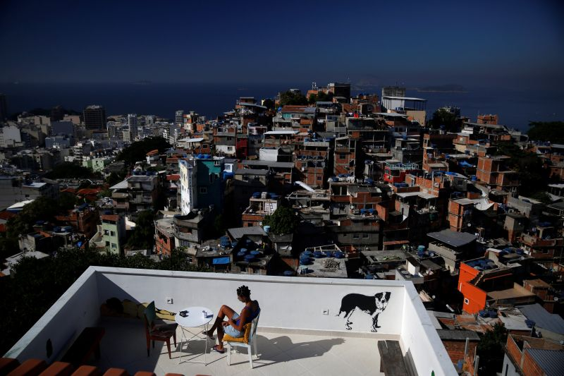 A woman sits on a terrace at Tiki hostel in Cantagalo favela, in Rio de Janeiro, Brazil, May 4, 2016. ― Reuters pic