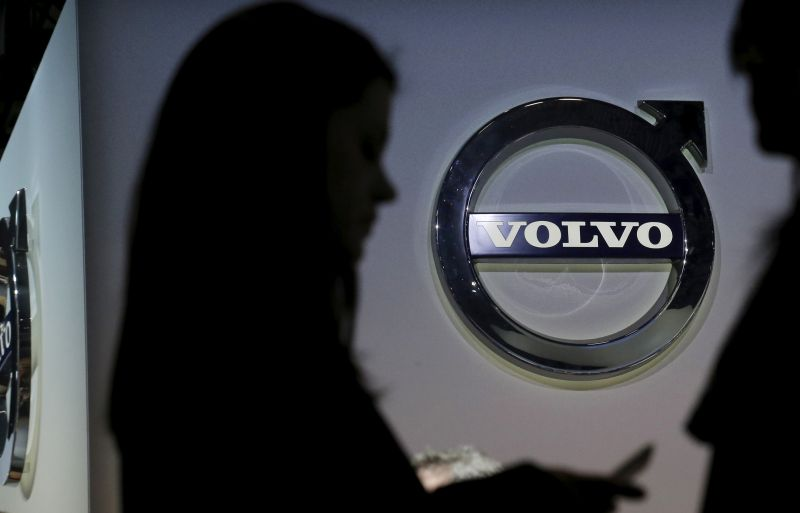 People are seen in silhouette near the Volvo auto stand during the media preview of the 2016 New York International Auto Show in Manhattan, New York March 24, 2016. ― Reuters pic