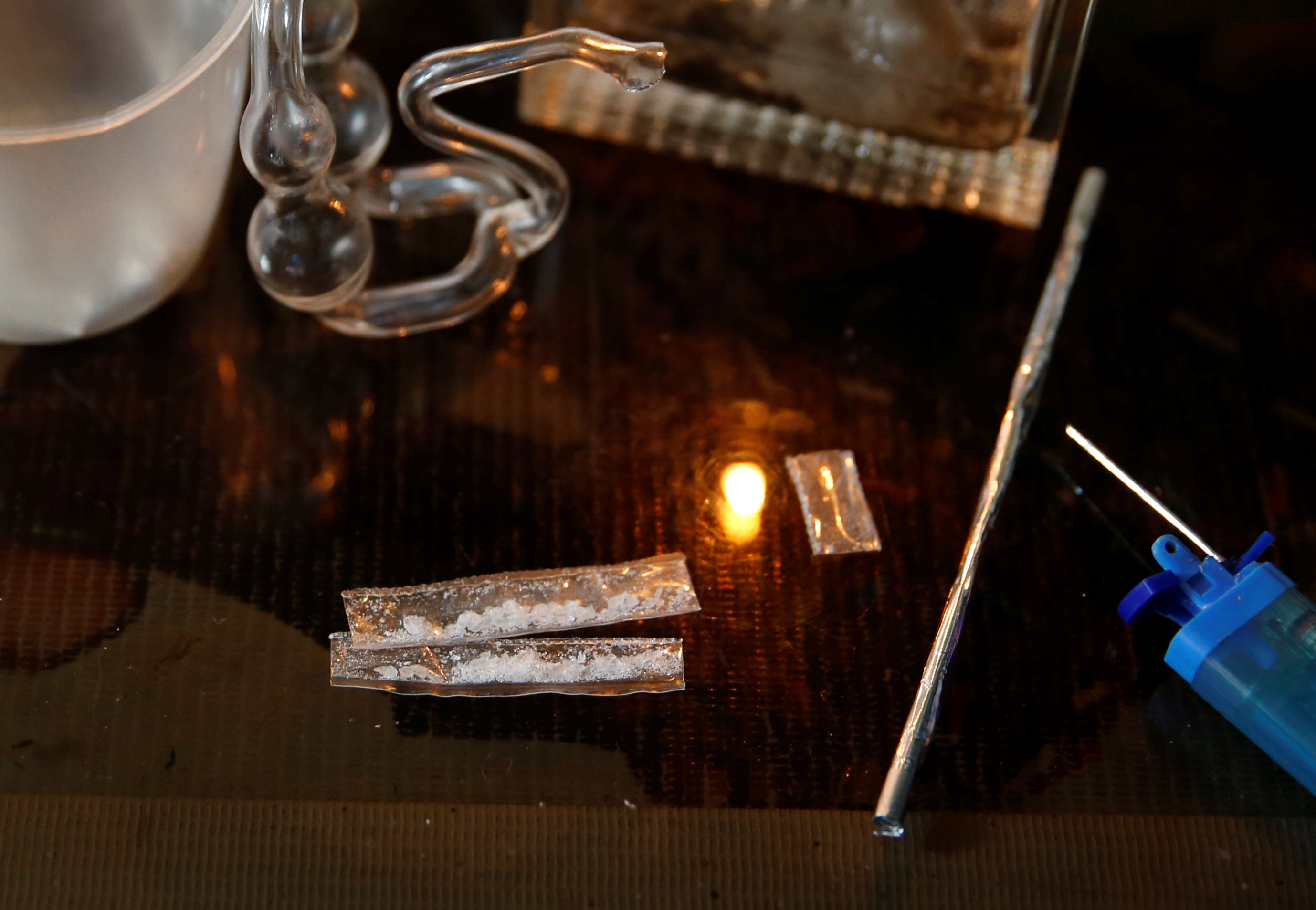 Sachets of syabu, or methamphetamine are pictured among other drugs paraphernalia at an undisclosed drug den in Manila June 20, 2016. — Reuters pic