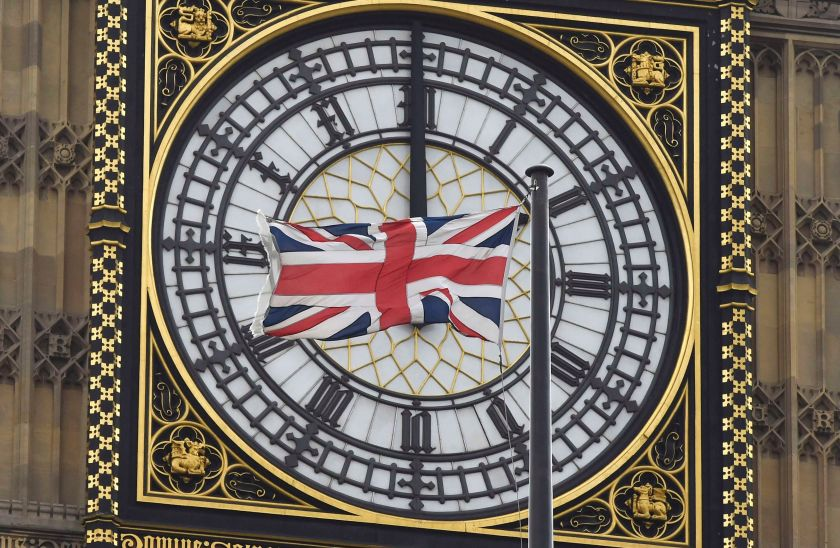 A British Union flag flutters in front of one of the clock faces of the 'Big Ben' clocktower of The Houses of Parliament in central London February 22, 2016. — Reuters pic