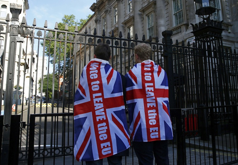 Vote leave supporters wear Union flags, following the result of the EU referendum, outside Downing Street in London, Britain June 24, 2016. — Reuters pic