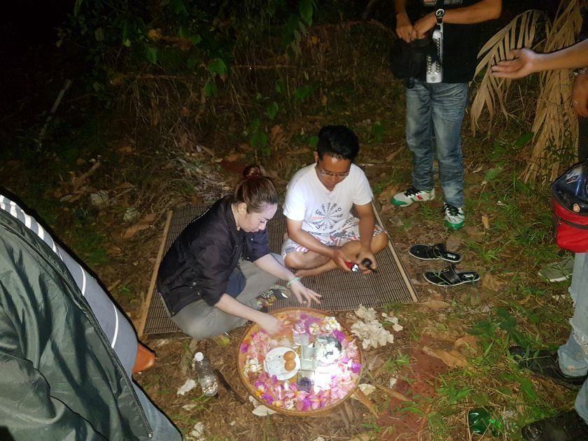 The Borneo Paranormal group presents offerings to ghosts in the hopes of appeasing them to appear on camera. — Picture courtesy of Sabah Underground Paranormal.