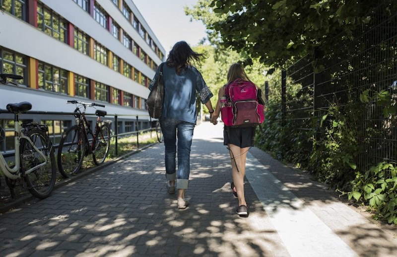 A woman walks with her 11-year-old daughter after picking her up from school in Berlin June 23, 2016. Is it possible to regret becoming a mother? The question first posed by an Israeli researcher has stirred a debate in Germany like in no other country, shattering a long-held taboo. — AFP pic