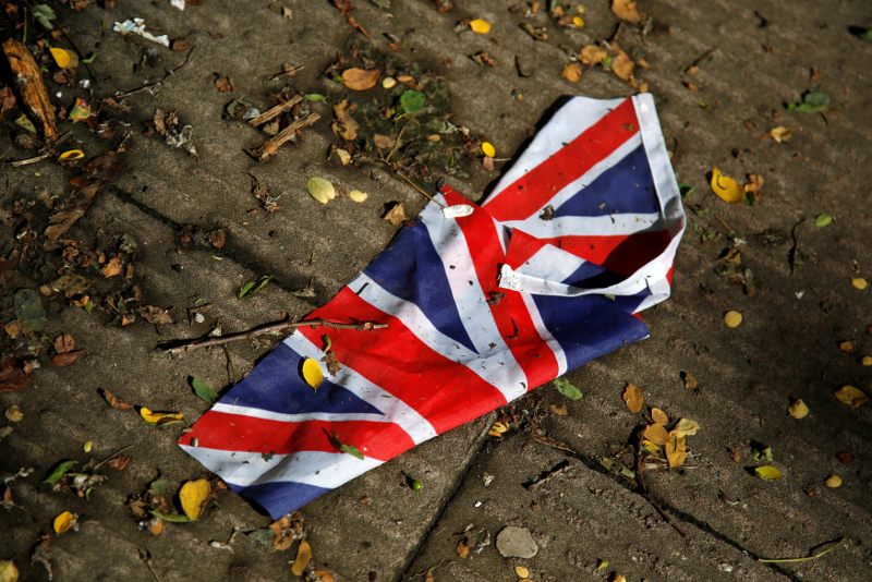 A British flag which was washed away by heavy rains the day before lies on the street in London June 24, 2016 after Britain voted to leave the European Union in the EU Brexit referendum. — Reuters pic