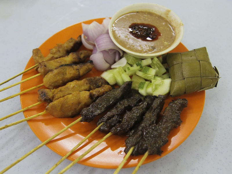 Satay is always served with a peanut sauce with a dollop of sambal, chunks of raw cucumber and onions and of course ketupat.