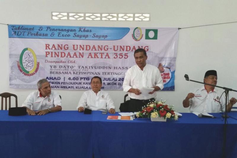 PAS secretary-general Datuk Takiyuddin Hassan (standing) during a briefing on Datuk Seri Abdul Hadi Awang's Private Member's Bill for Malay rights group Perkasa, July 24, 2016. — Picture courtesy of Datuk Ibrahim Ali