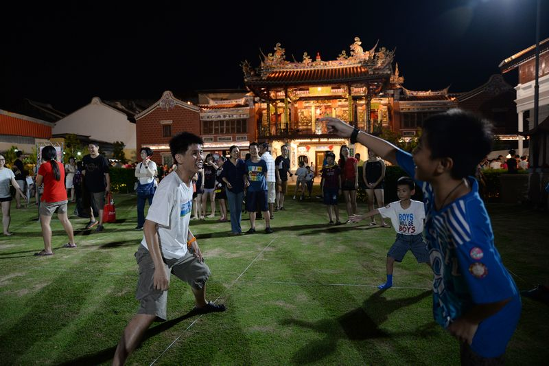 Young and old playing the 'Kali Toi' at the Cheah Kongsi compound during the George Town Heritage celebration July 9, 2016. — Picture by KE Ooi
