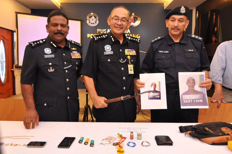 Penang police chief Datuk Abdul Ghafar Rajab (centre) showing the items seized from a suspect, following the defiling of deities at a Hindu temple, July 14, 2016. — Picture by KE Ooi