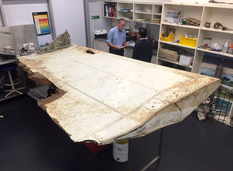 Australian and Malaysian officials examine aircraft debris at the Australian Transport Safety Bureau headquarters in Canberra, Australia, July 20, 2016 after it was found on Pemba Island, located near Tanzania. ― Reuters pic