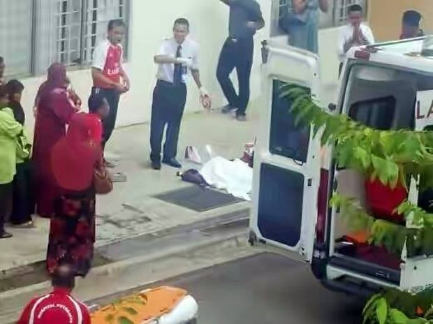 The body of a Sekolah Menengah Kebangsaan (SMK) Presint 9 (2) Form 3 pupil who fell from the third floor of the school building. — Picture courtesy of Facebook/Friends of Southern