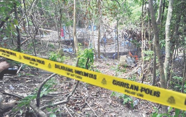 The camp used by human trafficking syndicates uncovered in Wang Kelian in May last year. — Malay Mail pic