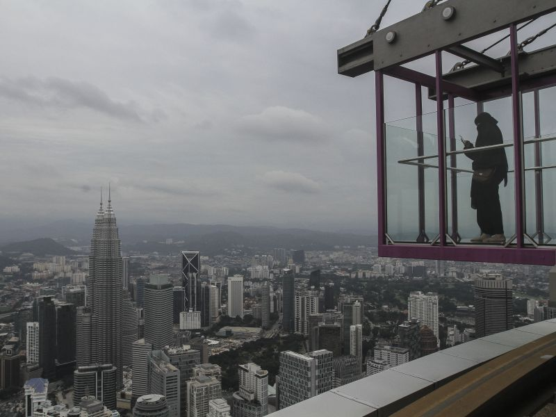 The city of Kuala Lumpur is an expensive place to live in... and many graduates find that their degrees no longer guarantee them high-paying jobs. ― File pic