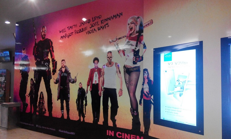 A cardboard poster of 'Suicide Squad' displayed at the TGV cineplex in KLCC shows the characters in their original outfits, August 4, 2016.