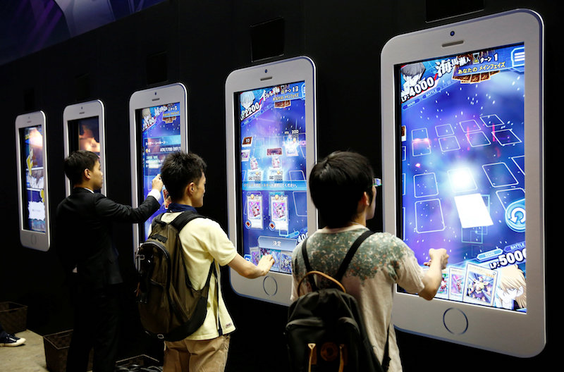 People play video games on mobile phone-shaped screens at Tokyo Game Show 2016 in Chiba, east of Tokyo, September 15, 2016. — Reuters pic