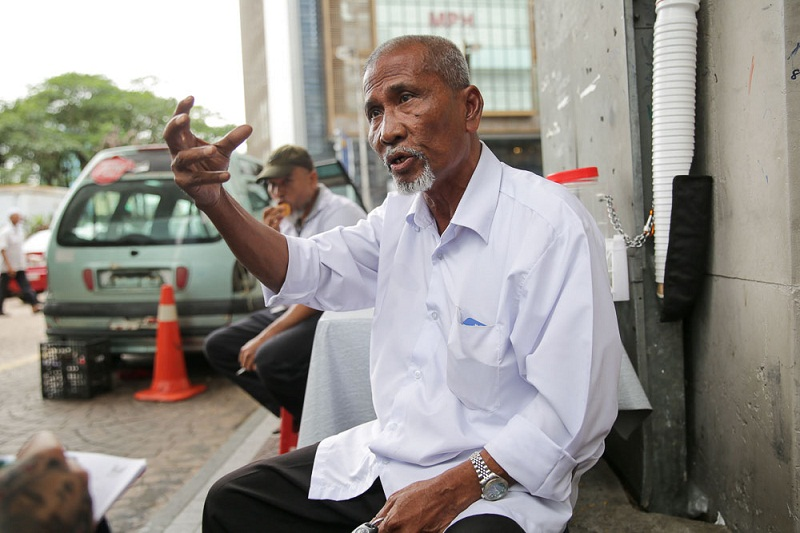 Mohd Yusof Mohd Diah, 65, says taxi drivers have invested too much in their taxis to make that change to Uber and Grab. — Pictures by Choo Choy May