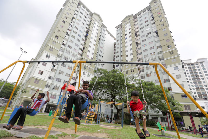 Children play in the small playground at the Kota Damansara PPR. The Federal Territories Ministry is in talks to provide free bus service to children living in PPRs around the capital. — Picture by Choo Choy May