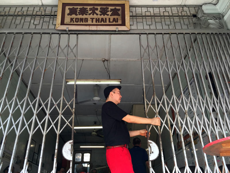 Calling it a day after 100 years...Gary Tan closing the Kong Thai Lai coffeeshop for the last time at Hutton Lane in George Town, Penang, September 26, 2016. — Picture by KE Ooi