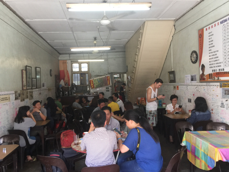 The last day... Kong Thai Lai Coffeeshop is packed with customers on its final day before it closes for good in this location where it has been in business for almost 100 years. — Picture by Opalyn Mok