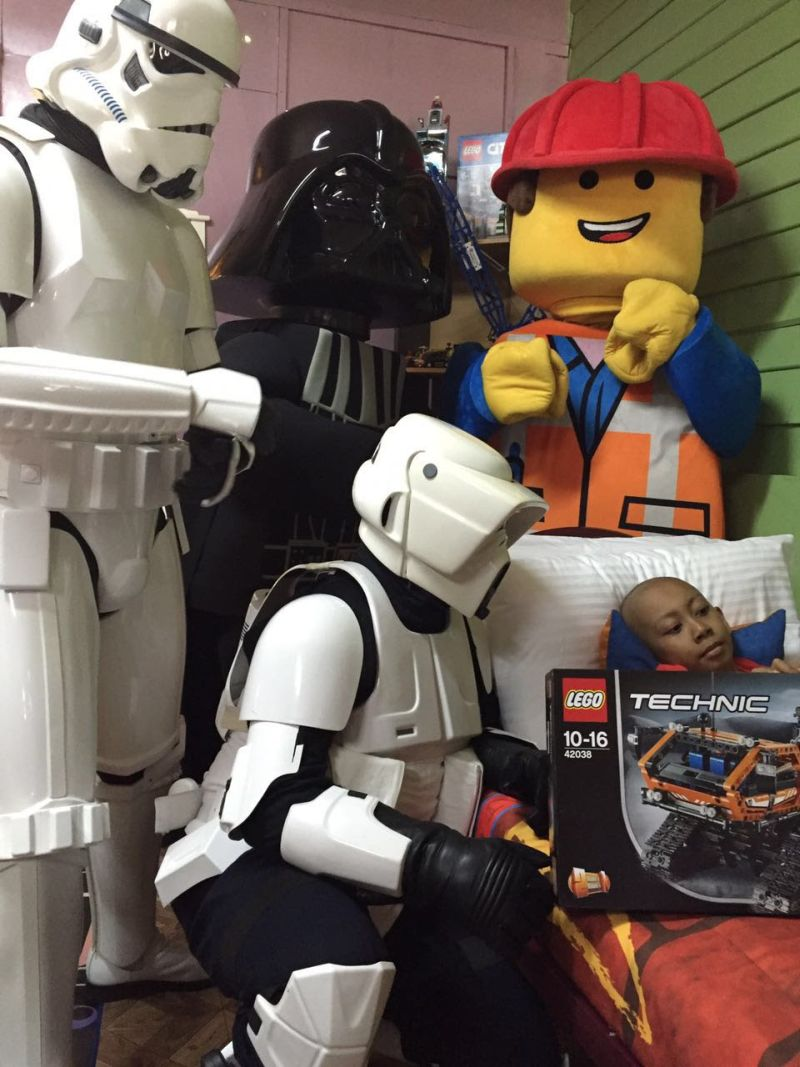 Muhammad Danish Maarif with the Star Wars Storm Troopers, Darth Vader  and  LEGO mascots who were present to meet him. ― Pictures by Legoland Malaysia Resort