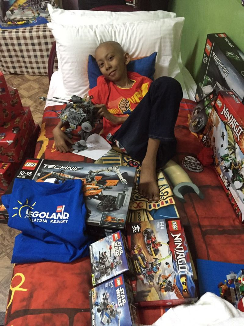 Danish, smiling, happy to receive LEGO toys and merchandises delivered to him.