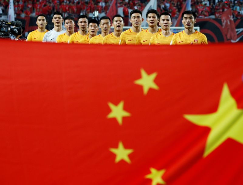 When it matters, all China have to show for the big-money transfers to their domestic league is the parade of their national flag. — Reuters pic
