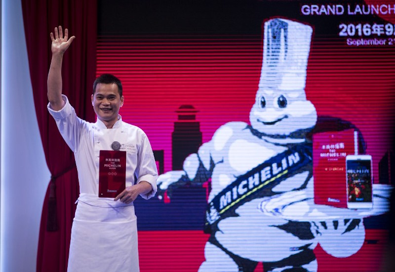 File picture of Master chef of T'ang Court, Justin Tan reacts on stage after the announcement of his three stars award of the Michelin Guide Shanghai September 21, 2016. Next year's ceremony in France to bestow Michelin stars on standout restaurants has been cancelled due to the coronavirus epidemic, the famous red guide said today. — AFP pic