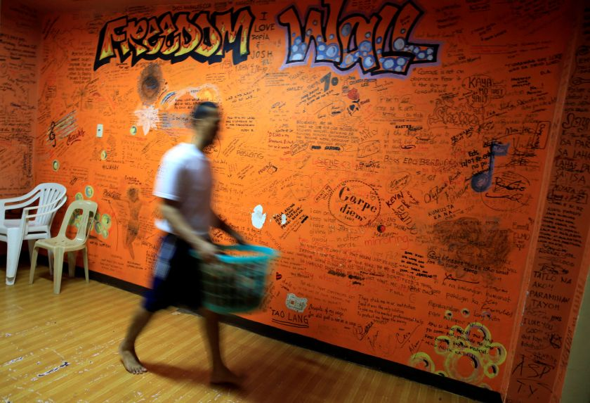 A drug user undergoing rehabilitation walks past a 'Freedom Wall' with inspirational messages written by his fellow patients at the Centre for Christian Recovery in Antipolo, Philippines September 12, 2016. — Reuters pic