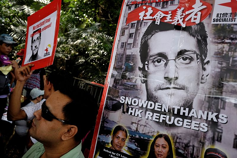 Refugees and protesters supporting Edward Snowden demonstrate outside the US Consulate as they demand that US President Barack Obama grant Snowden a pardon, in Hong Kong September 25, 2016. ― Reuters pic