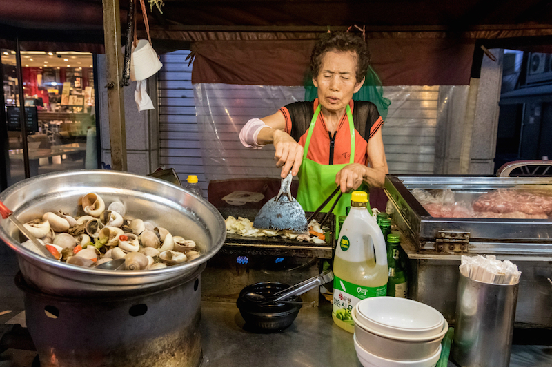 Kim Il-sun prepares dalkgalbe — spicy chicken with vegetables, stir-fried in soju — at Auntie's Soju Tent. — Reuters pic
