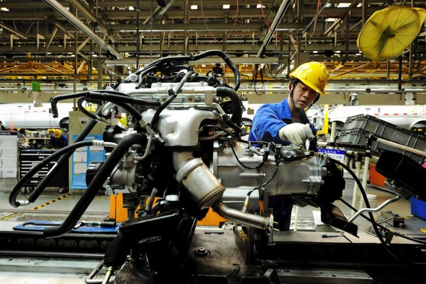 The official manufacturing Purchasing Manager's Index (PMI) eased to 50.4 in July from 50.9 in June, data from the National Bureau of Statistics (NBS) showed today, but remaining above the 50-point mark that separates growth from contraction. ― Reuters pic
