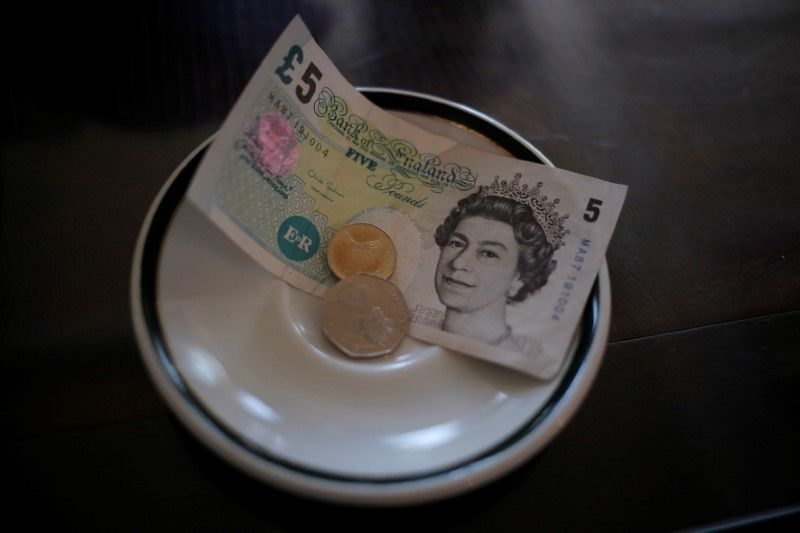 An English £5 note and coins are seen at a restaurant in the British overseas territory of Gibraltar in this picture released October 5, 2016. — Reuters pic