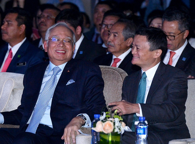 Prime Minister Datuk Seri Najib Razak having a light moment with Executive Chairman of Alibaba Group Jack Ma (right) during the launching ceremony of Alitrip Malaysia Tourism Pavilion in Beijing November 4, 2016. — Bernama pic