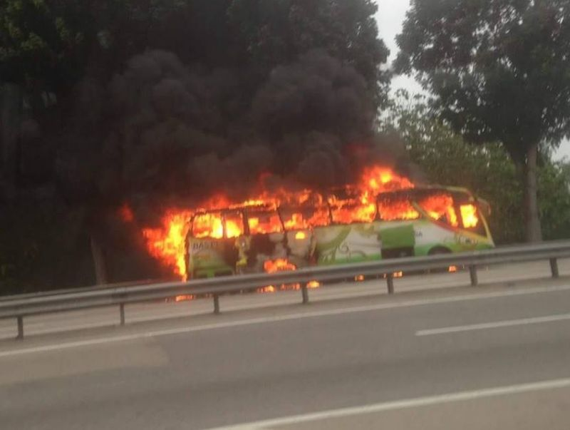 File picture of a bus on fire following an accident in Batu Pahat in November 2016. — Picture via Facebook/Putera Karya
