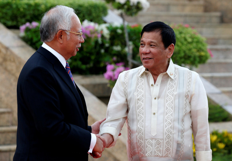 Rodrigo Duterte (right) had told Philippines media of his proposal to build a school and hospital for Filipino migrants in Malaysia and that Datuk Seri Najib Razak had agreed to it during their talks. — Reuters pic