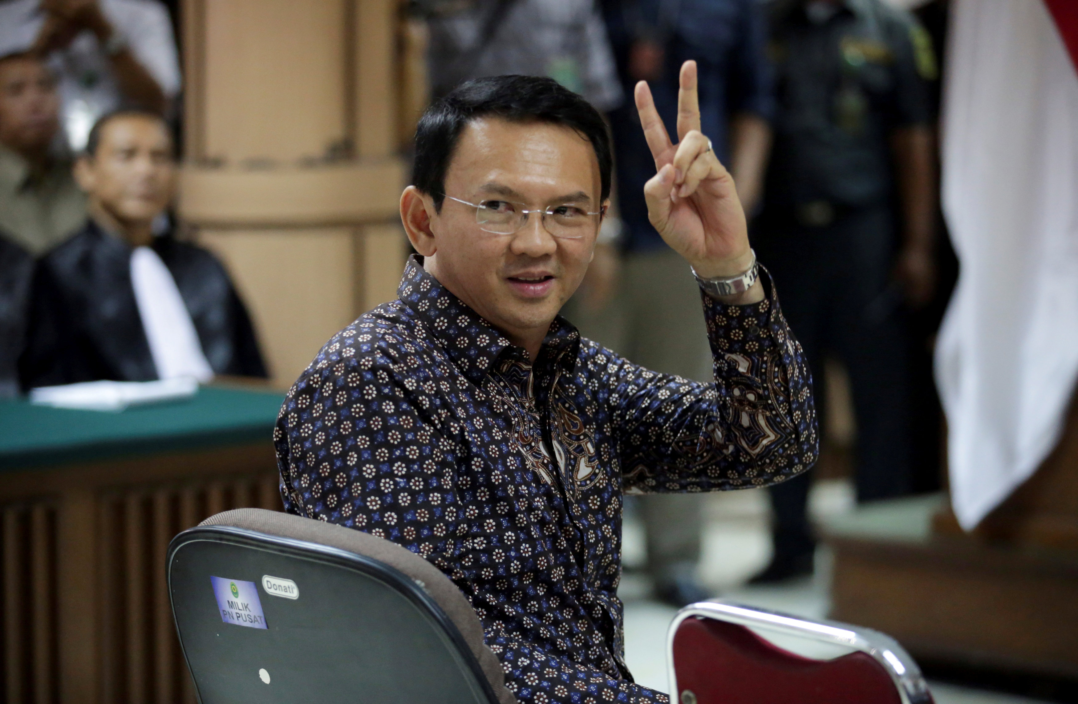 Jakarta's Governor Basuki Tjahaja Purnama gestures inside the courtroom during his blasphemy trial at the North Jakarta District Court in Jakarta, Indonesia, December 27, 2016. — Reuters pic