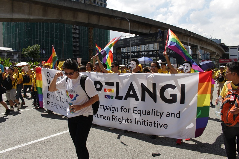 LGBT rights supporters join Bersih 5 rally holding a banner by the Pelangi Campaign for Equality and Human Rights Initiative in Kuala Lumpur November 19, 2016. — Picture courtesy of Joshua Tan