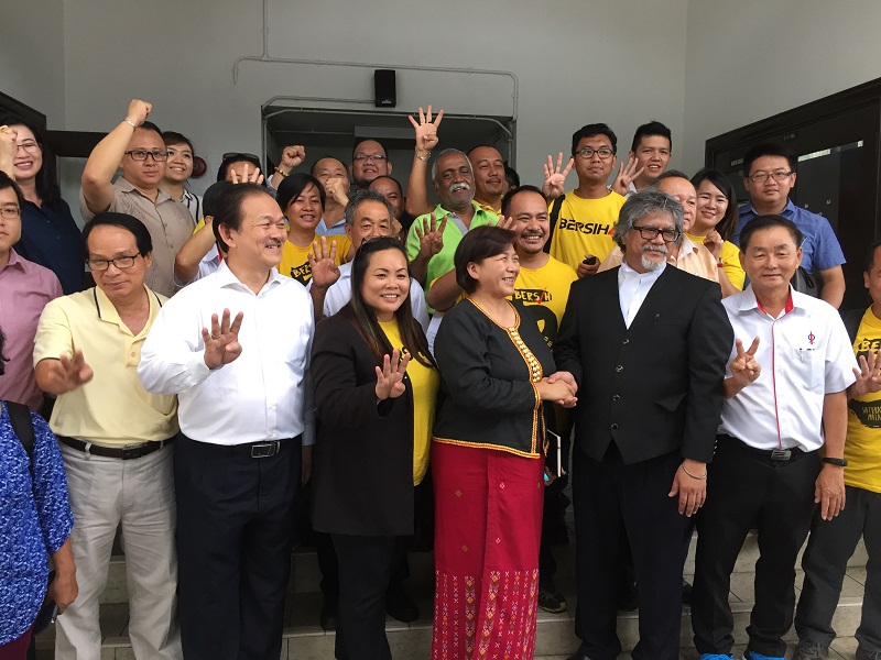 Former Sabah Bersih chairman Jannie Lasimbang (centre) celebrated at the Sabah courts today  after being discharged and acquitted her of failing to comply with the Peaceful Assembly Act when organising the Bersih gathering last year. — Picture by Julia Chan