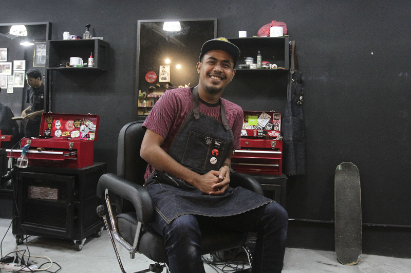 Slick co-founder Shazwan started up the business with only three barber chairs. — Picture by Yusof Mat Isa