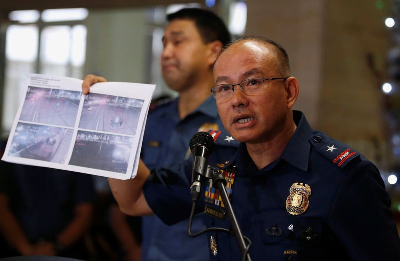 Philippines' Chief Superintendent Oscar Albayalde shows a copy of a closed circuit television printout, showing men involved in a foiled bomb attack plot in Manila on November 28, in Manila, December 7, 2016. — Reuters pic