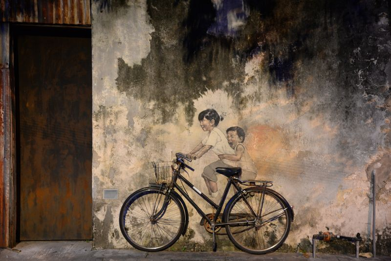 Zacharevic's mural of children on a bicycle in Armenian Street, Penang is one of his most iconic artwork. ― Picture by KE Ooi