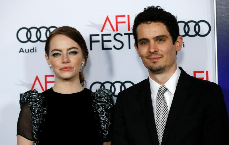 Director Damien Chazelle and cast member Emma Stone pose at the premiere of 'La La Land' during Afi Fest in Hollywood November 15, 2016. ― Reuters pic