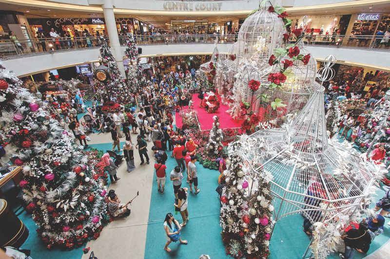 The exceptionally large crowd did not stop many from doing last-minute Christmas shopping at Mid Valley Megamall, December 24, 2016. — Picture by Hari Anggara