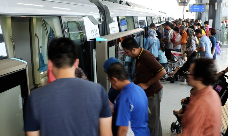 People taking advantage of the Christmas holiday to catch a free ride on the Mass Rapid Transit (MRT) Phase One line from the Sungai Buloh station to Damansara, December 25, 2016. — Bernama pic