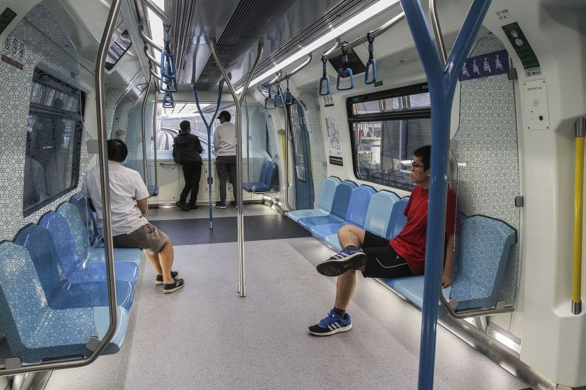 Commuters catch a ride on the maiden MRT service.