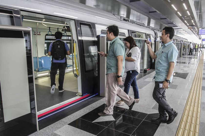 Commuters catch a ride on the maiden MRT service, which will be free to the public for a period of one month.