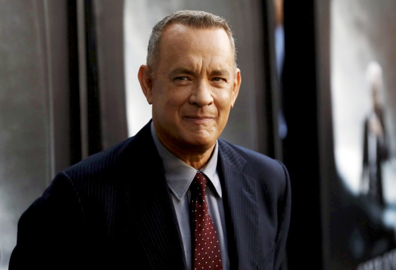 Tom Hanks was clearly delighted at the bright and shiny newly renovated vehicle. — Reuters pic